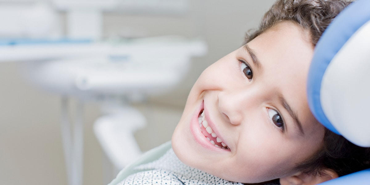 Child Smiling with dentist decorative photo